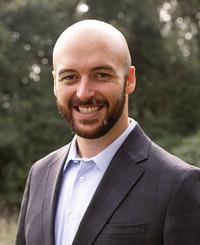 Agente de seguros Justin Lumsden