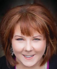 Agente de seguros Pam Lewis-Kidder
