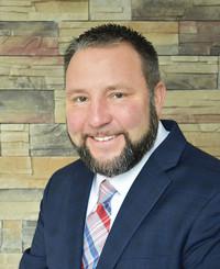Agente de seguros John Schragg