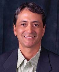 Insurance Agent Charlie Riesgo