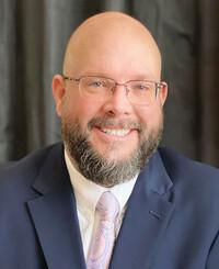 Agente de seguros Mike Mattingley