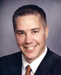 Agente de seguros Brett Baker