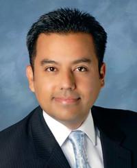 Insurance Agent Enrique Enriquez