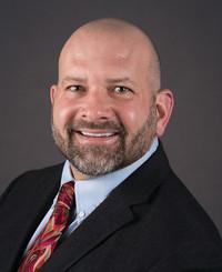 Agente de seguros Mike Kornafel
