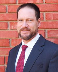 Agente de seguros Justin Riggan